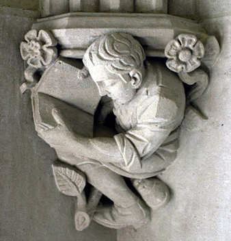 architectural detail of statue of man with book